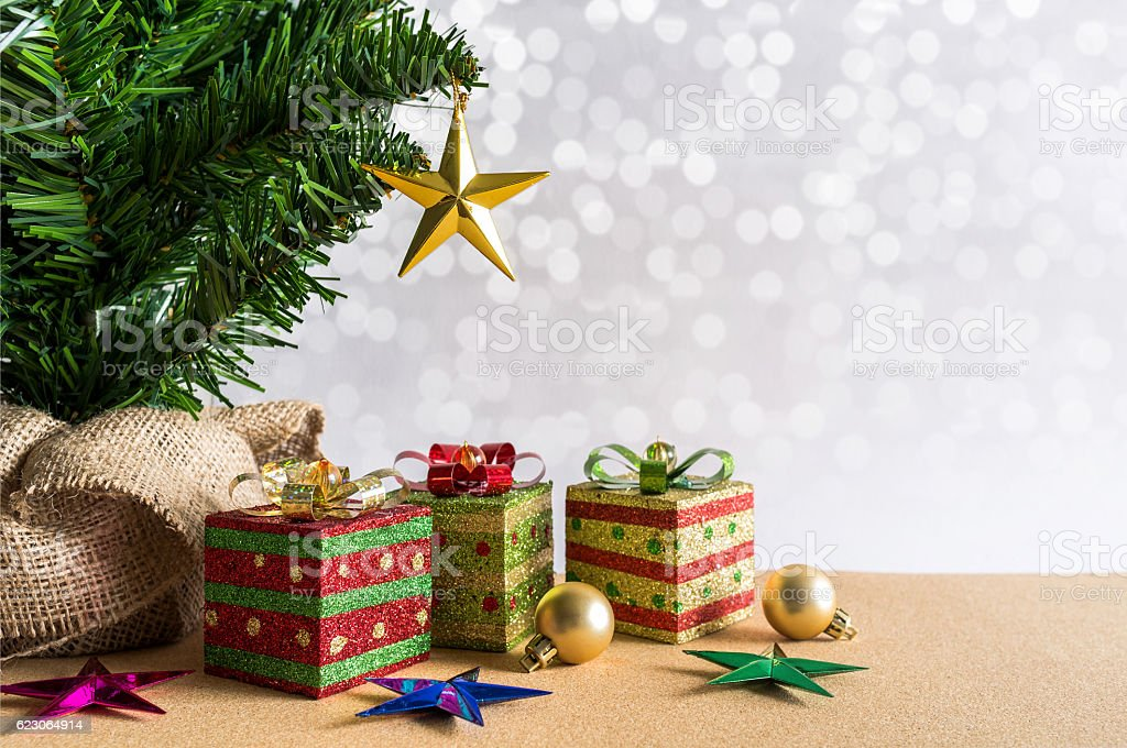 Christmas background. Christmas tree, golden balls and gift boxes. stock photo