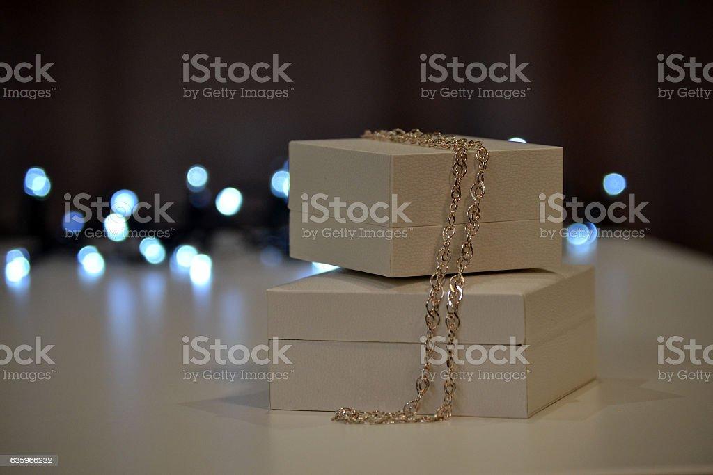 Christmas background. Gift boxes and christmas lights stock photo