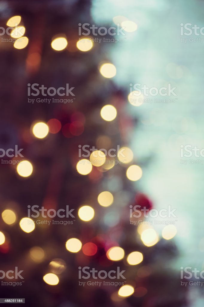 Christmas Background Glowing Lights off Evergreen Tree stock photo