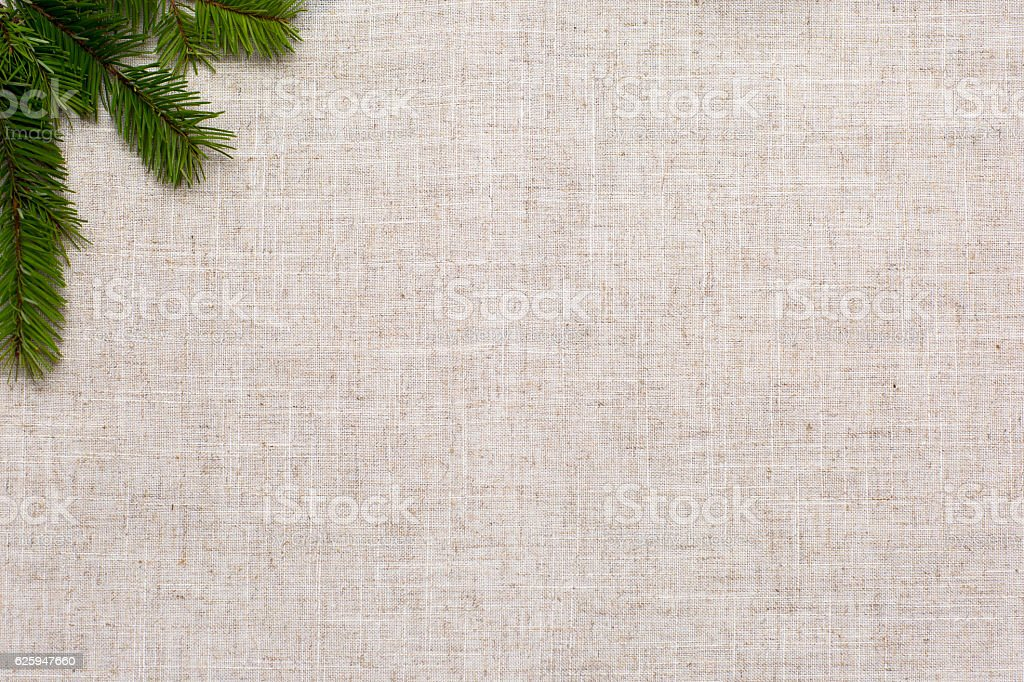 Christmas background, it's tree and flax fabric. stock photo
