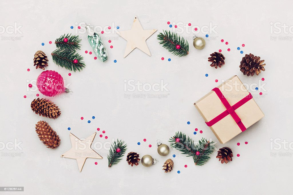 Christmas background of gift box, fir tree, cones, holiday decorations. stock photo