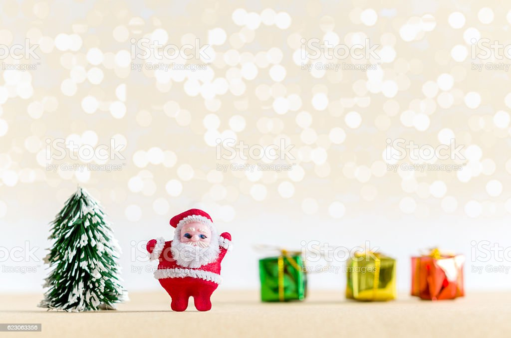 Christmas background. Santa Claus, christmas tree, and gift boxe stock photo