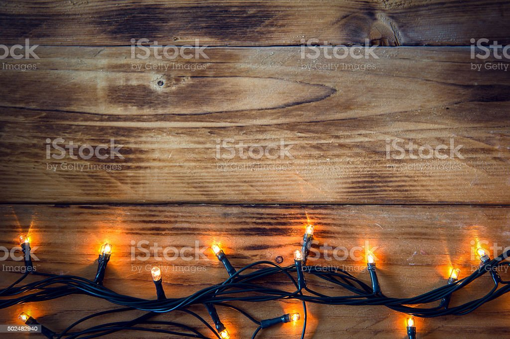 Christmas background - vintage planked wood with lights and text stock photo