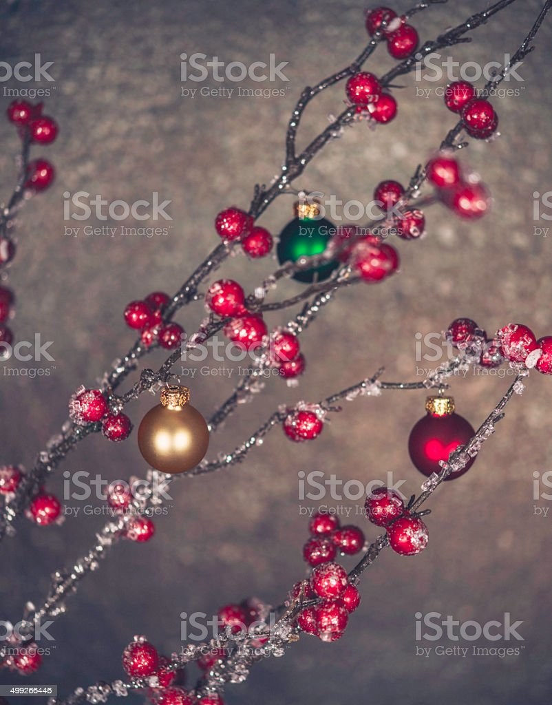 Christmas background with berries and baubles on branches stock photo