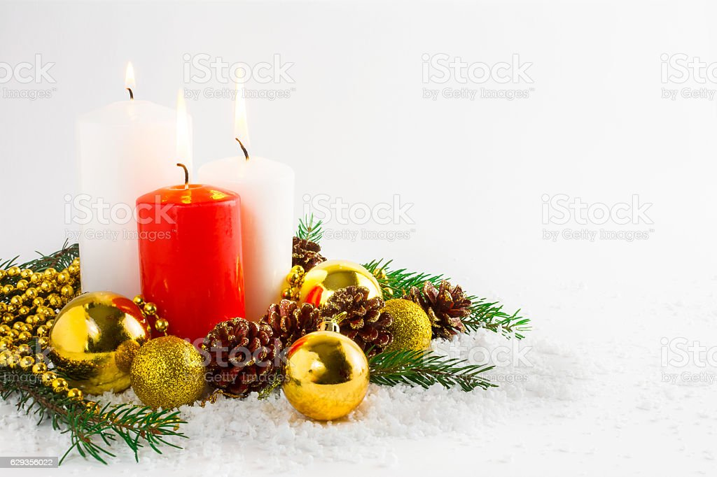 Christmas background with burning candles and golden ornaments stock photo