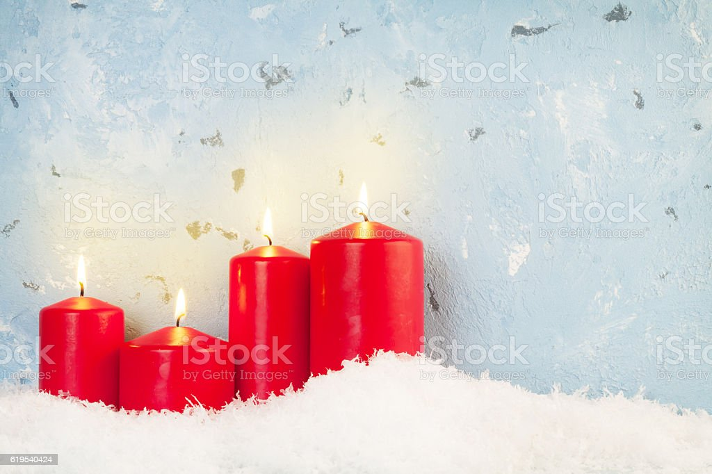 Christmas background with candles in snow stock photo