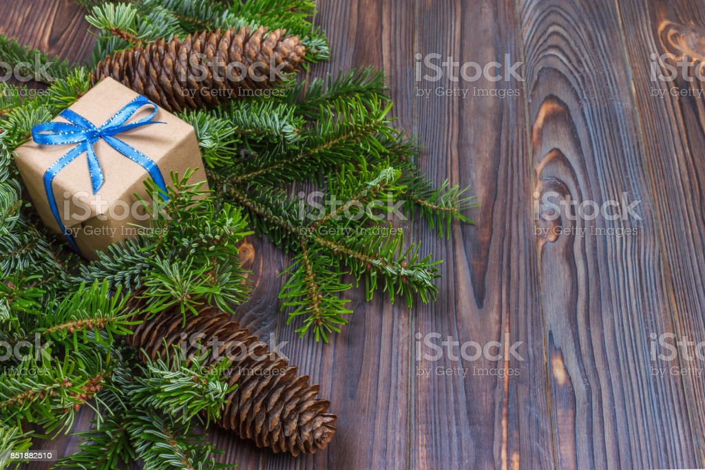 Christmas background with Christmas gift on wooden background with Fir branches. Xmas and Happy New Year composition. top view stock photo