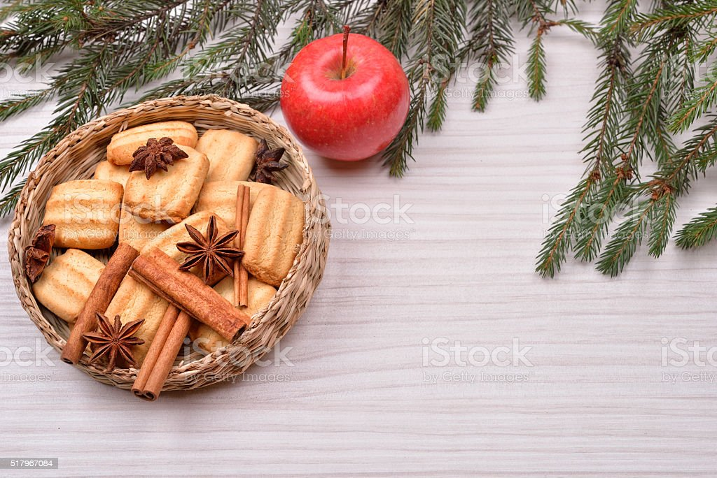 Christmas background with Christmas tree, gingerbread cookies with cinnamon stock photo