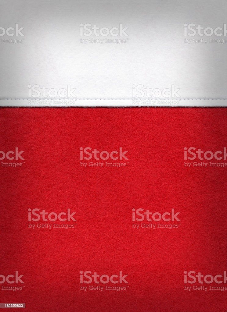 Christmas background with close-up of red and white stocking stock photo