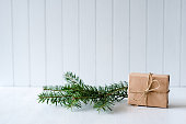 Christmas background with fir branches and gift - copy space