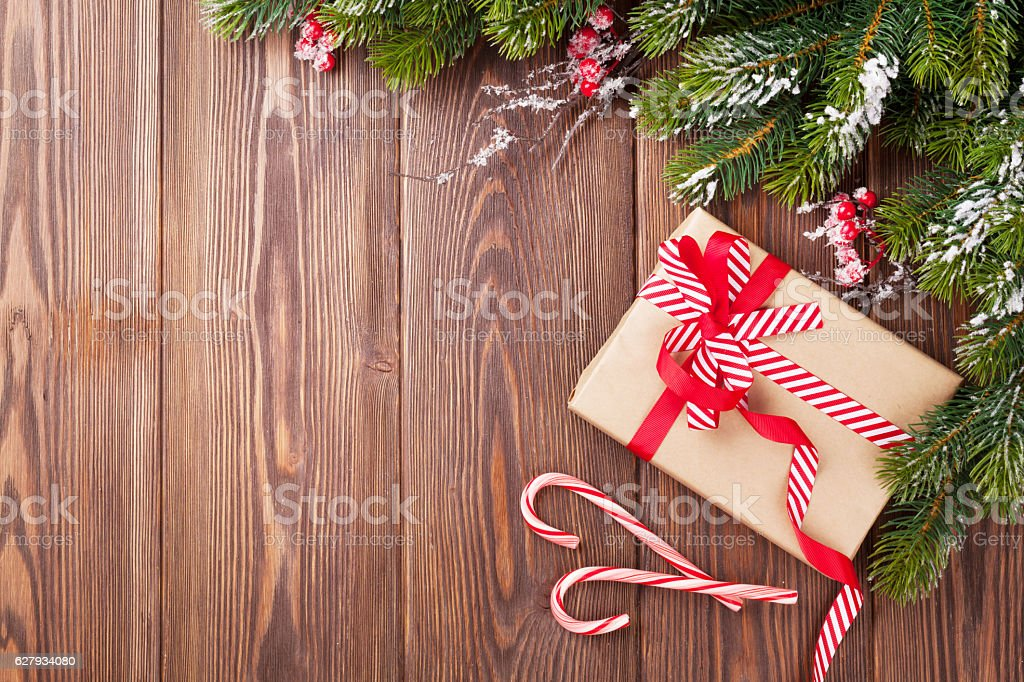 Christmas background with fir tree and gift box stock photo