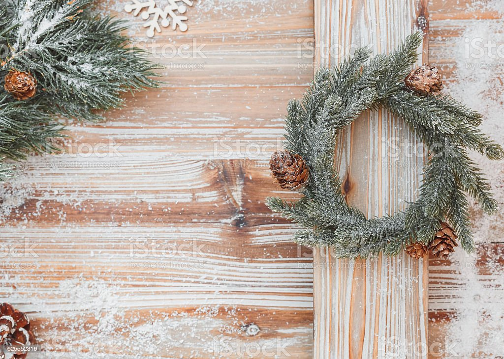 Christmas background with fir tree branches and mini wreath stock photo