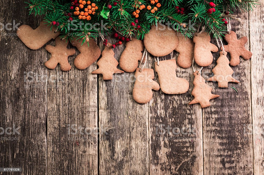 Christmas background with fir tree,Gingerbread Cookies and holiday decor stock photo