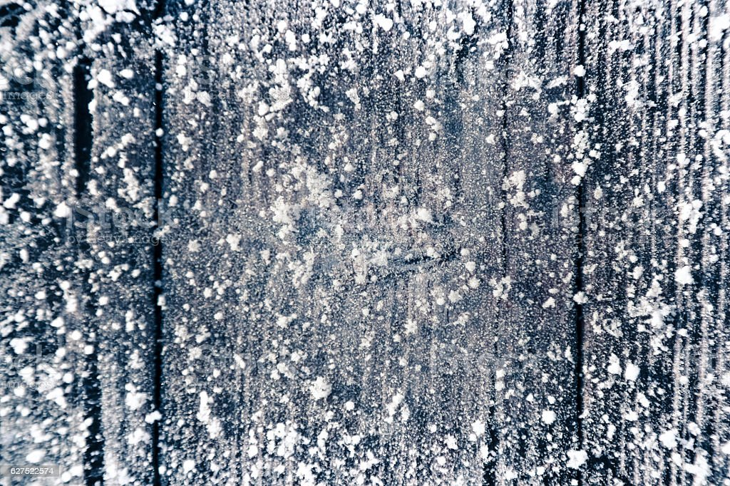 Christmas background with old wooden planks, frost and snow flakes stock photo