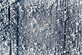 Christmas background with old wooden planks, frost and snow flakes