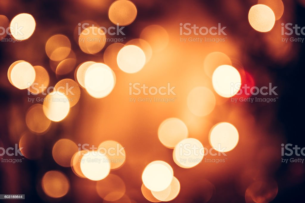 Christmas background with orange bokeh from candle lights stock photo