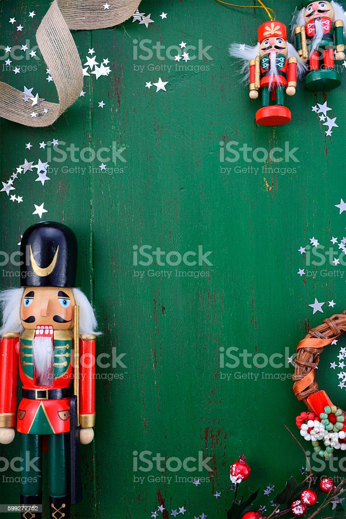 Christmas background with ornaments on green wood table. stock photo