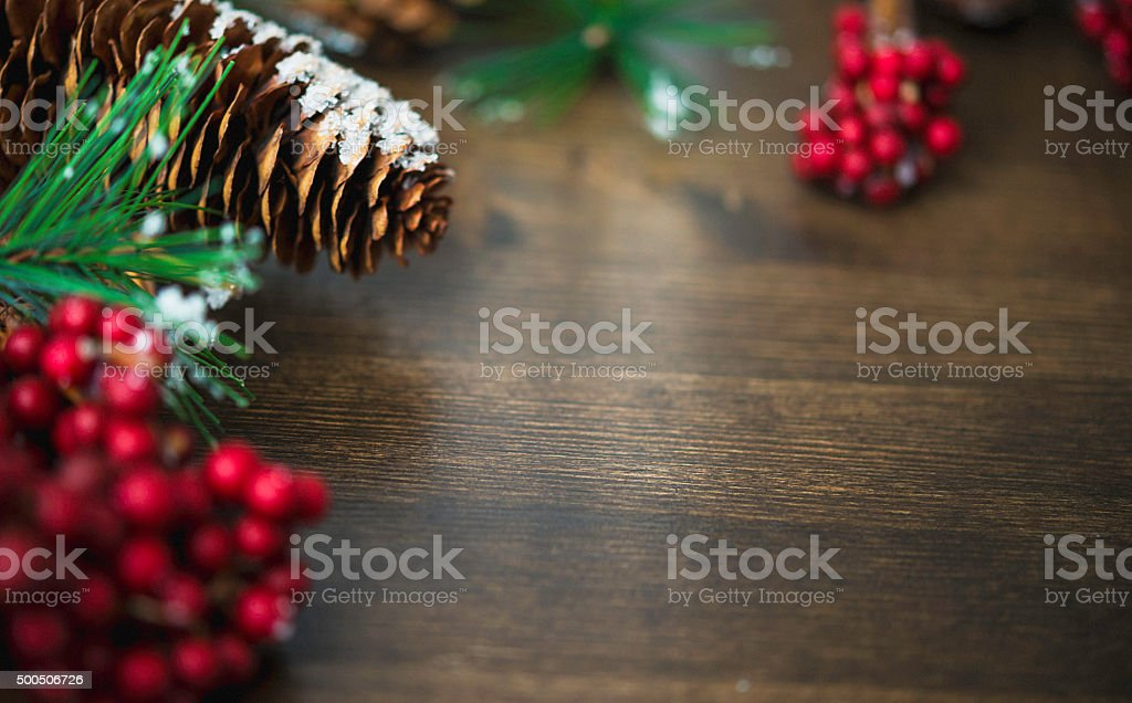 Christmas background with pinecones and berries stock photo