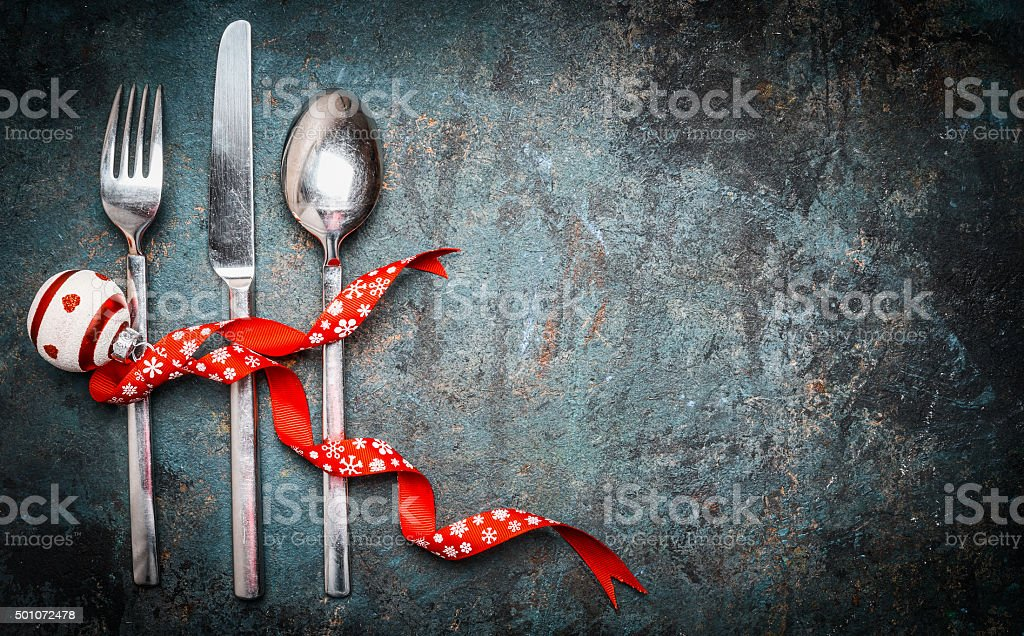 Christmas background with place setting silverware and red decoration stock photo