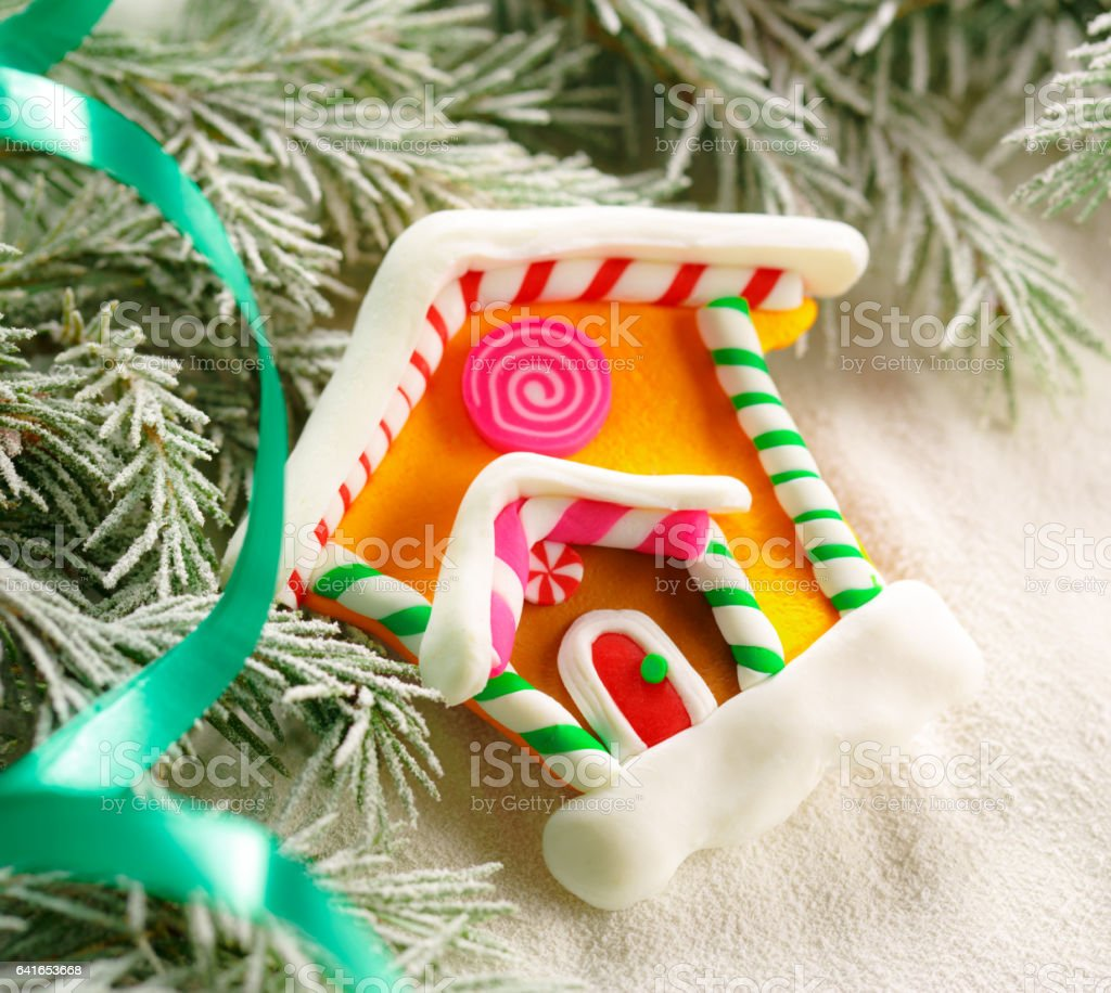 Christmas background with snow, firtree and house stock photo