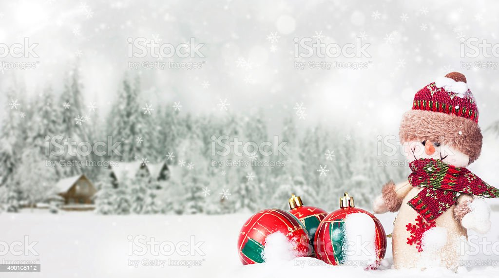 Christmas background with snowman in the snow stock photo
