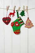 Christmas background with traditional decorations hanging on a rope