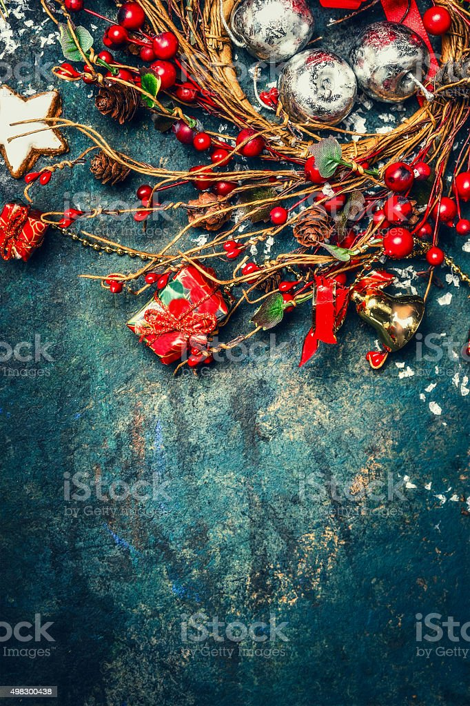 Christmas background with wreath of winter berries, decorations and cookies stock photo