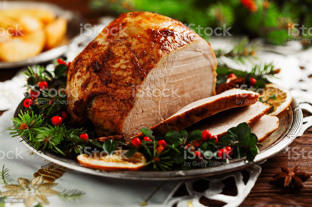 Christmas baked ham, served on the old plate. stock photo