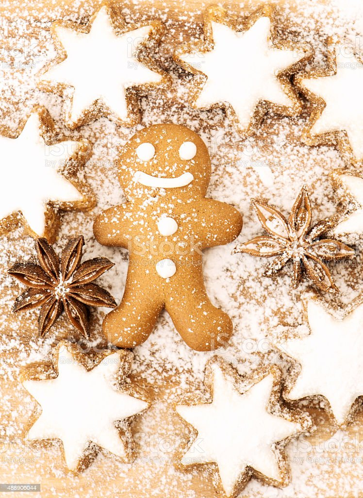 Christmas bakery. Gingerbread man cookie, cinnamon stars and star anise stock photo