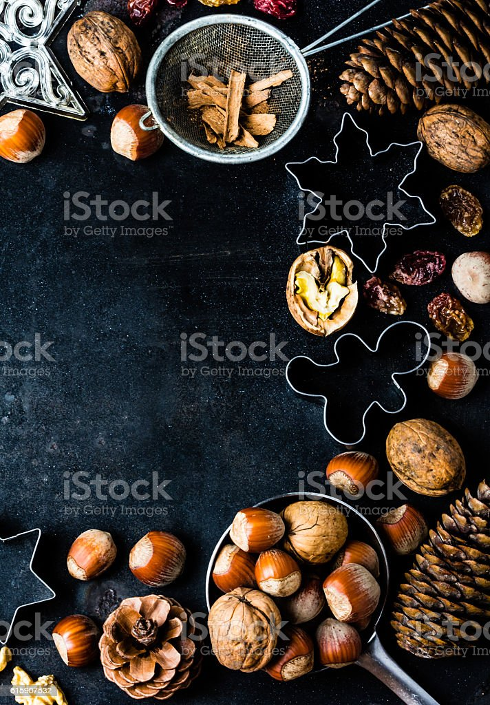 Christmas baking background - cookie cutters, spices, nuts, Holiday decorations stock photo