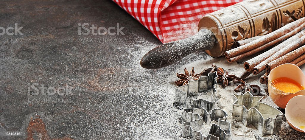 Christmas baking ingredients and tolls for dough preparation stock photo
