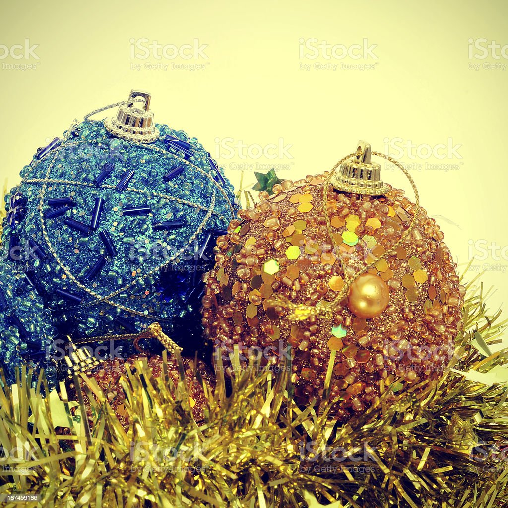 christmas ball and golden tinsel with a retro effect royalty-free stock photo