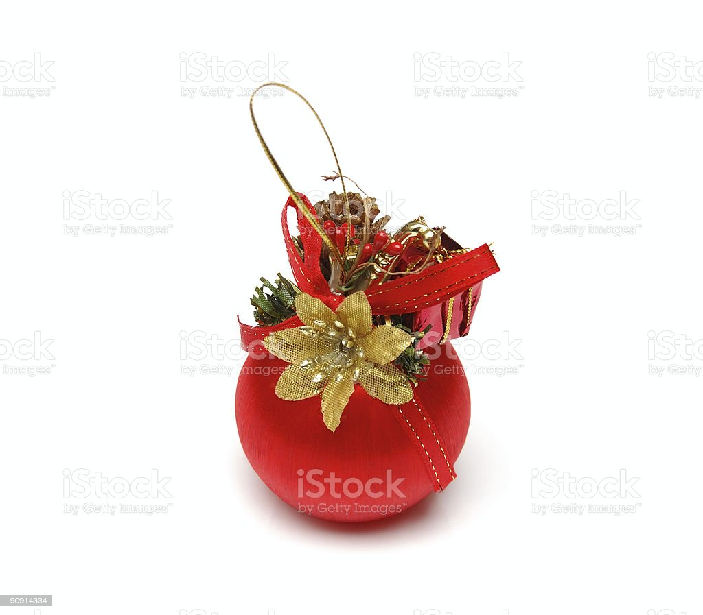 christmas ball of red color with a goldish flower royalty-free stock photo