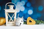 Christmas ball tree and lantern on blue bokeh light background