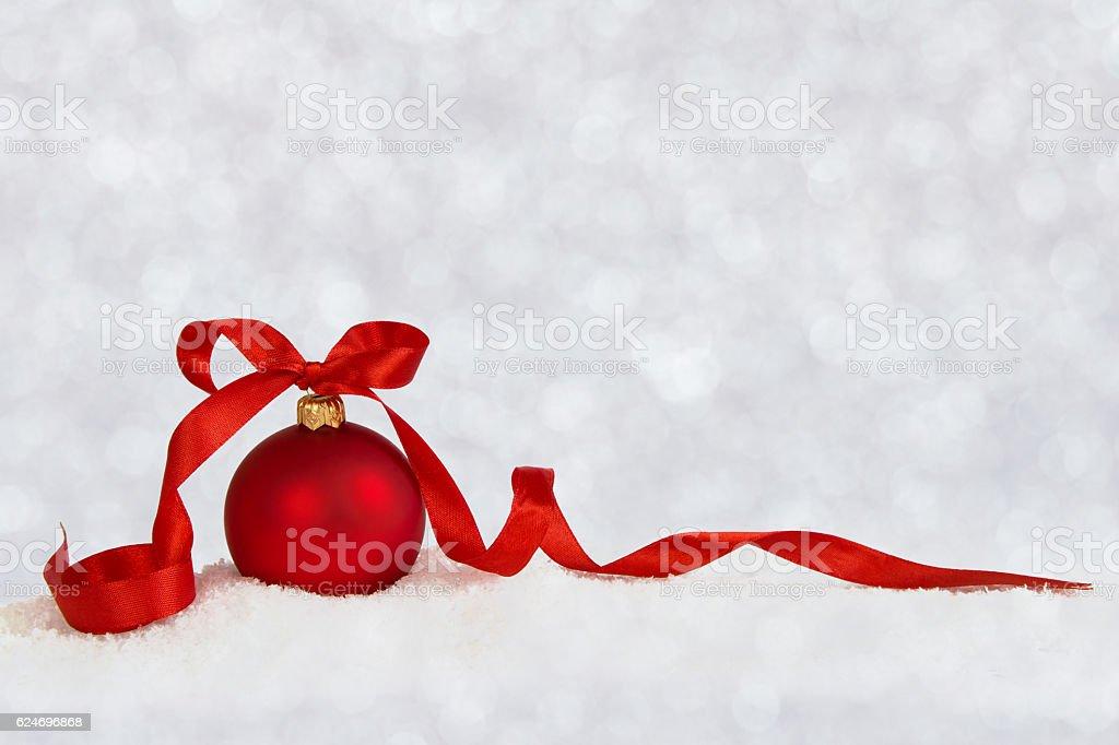 christmas ball with ribbon defocused stock photo