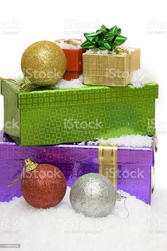 Christmas balls and gift boxes on snow royalty-free stock photo