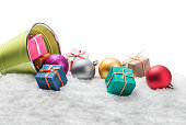 Christmas balls and gifts on snow isolated  white