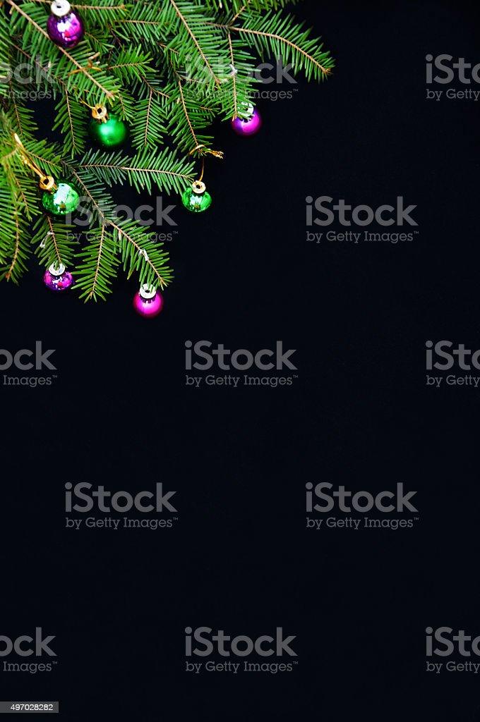 Christmas balls hanging on fir tree royalty-free stock photo