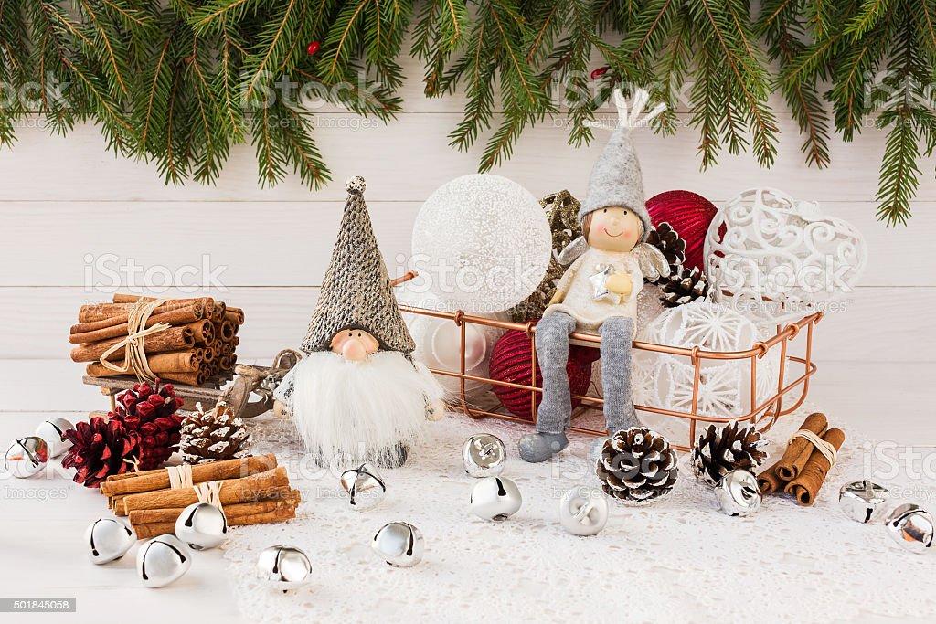 Christmas balls in basket, gnome and angel, Christmas tree stock photo