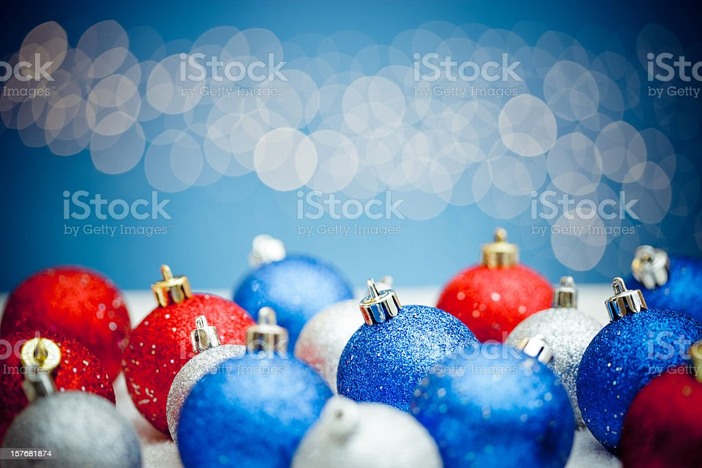 Christmas balls on snow with lights background royalty-free stock photo