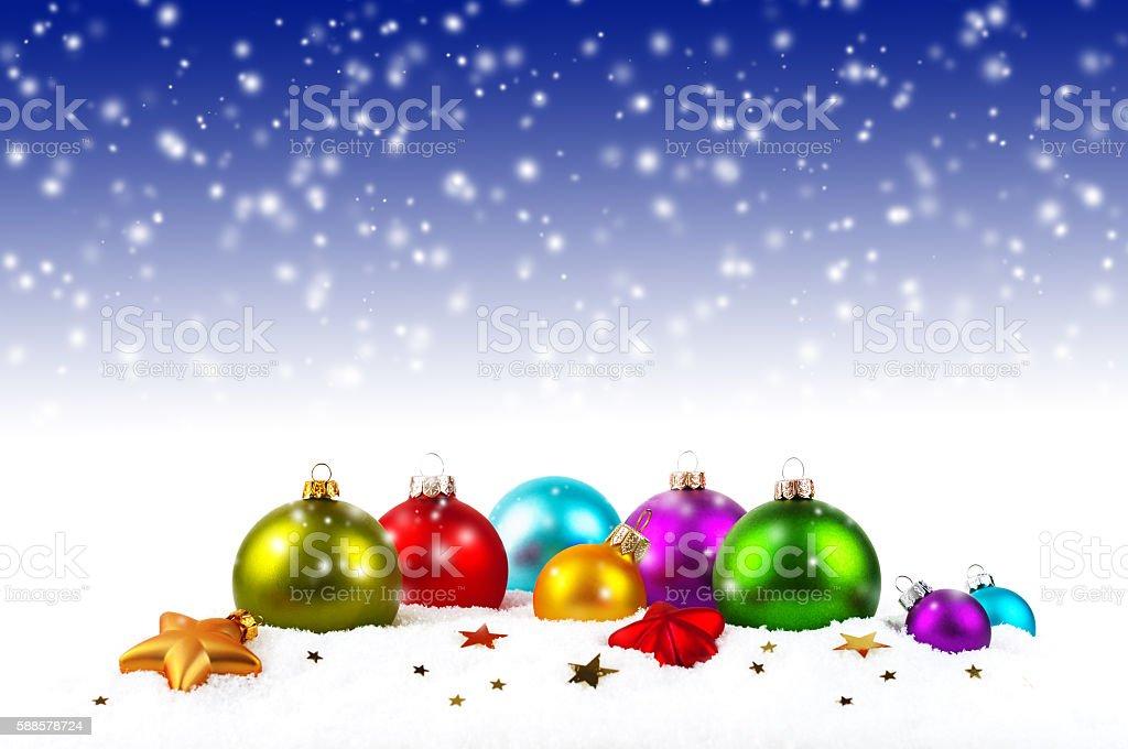 Christmas balls on the snow stock photo