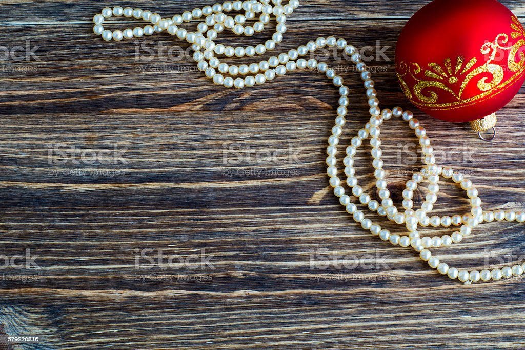 Christmas balls on wooden background, flat lay. stock photo