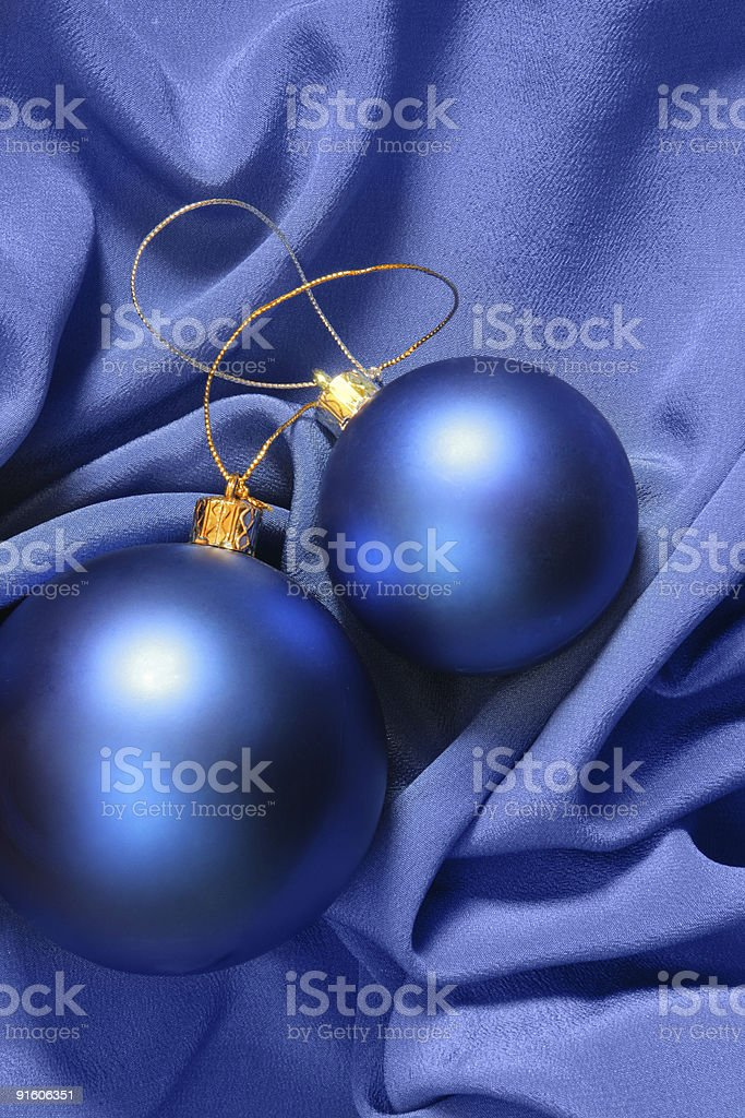 Christmas balls over blue silk royalty-free stock photo
