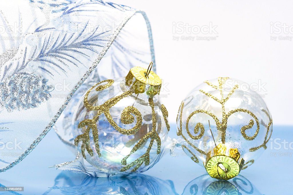 Christmas balls with ribbon on blue background royalty-free stock photo