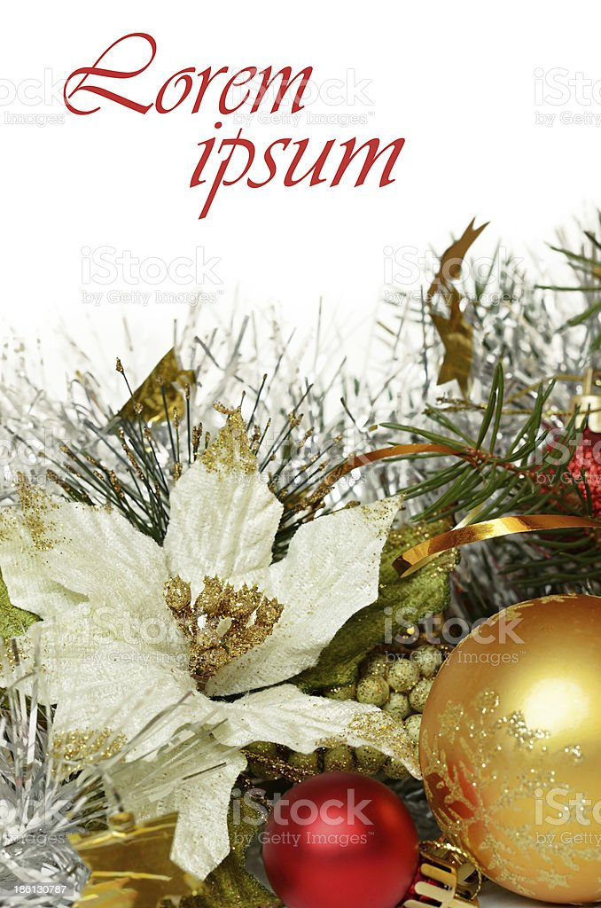 Christmas balls with tinsel and artificial poinsettia royalty-free stock photo