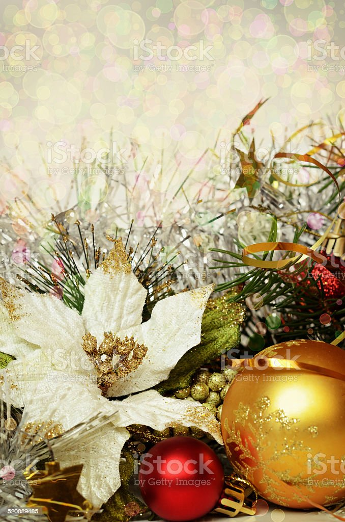 Christmas balls with tinsel and artificial poinsettia stock photo