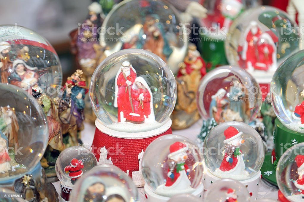 Christmas balls with water inside and Nativity Scene stock photo