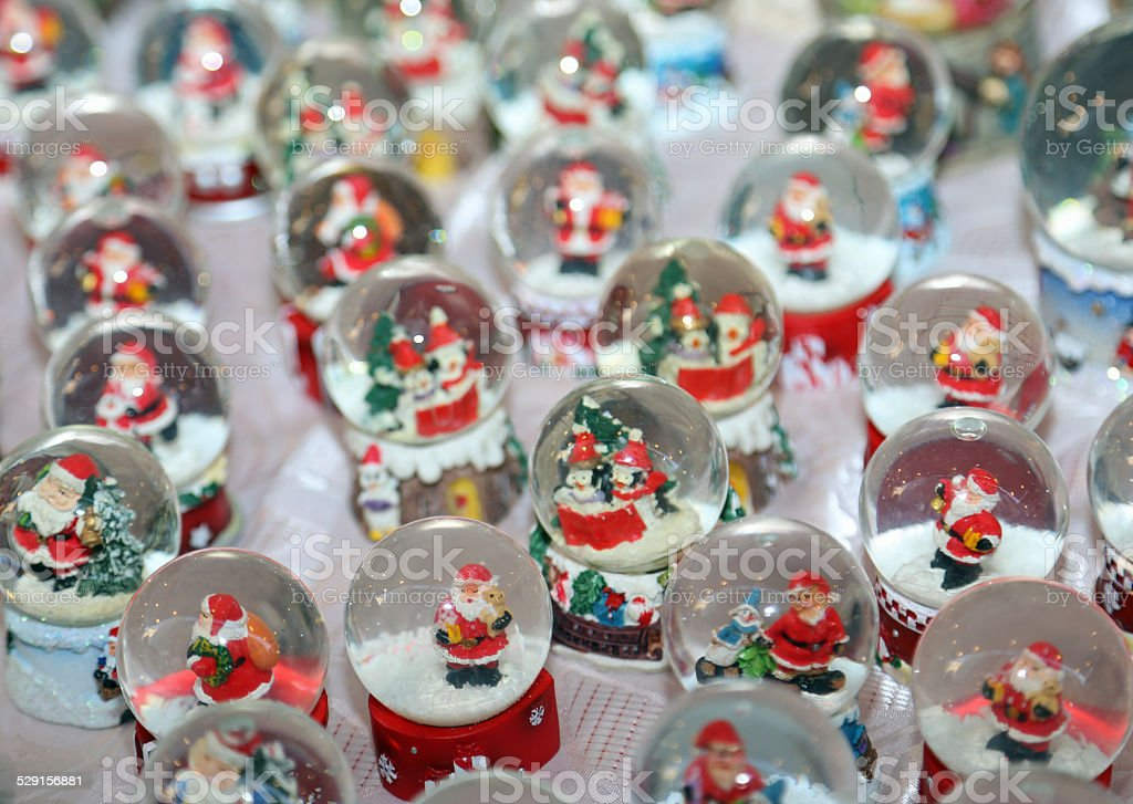Christmas balls with water inside and Santa Claus as decoration stock photo