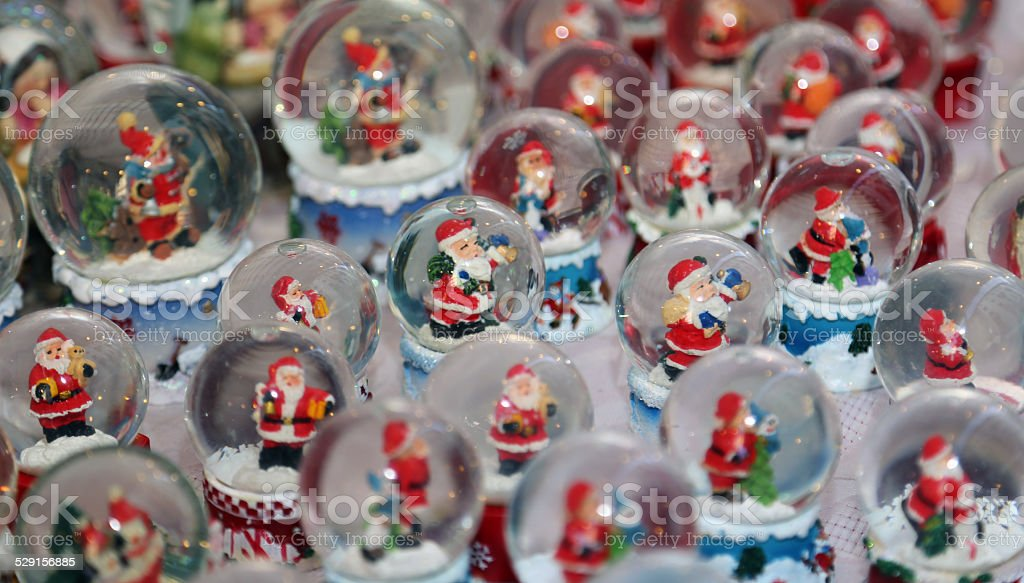 Christmas balls with water inside and Santa Claus stock photo