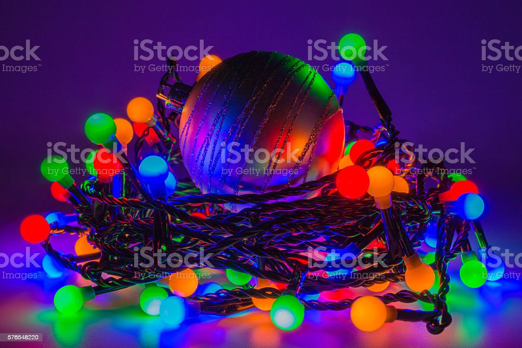 christmas bauble and fairy lights stock photo